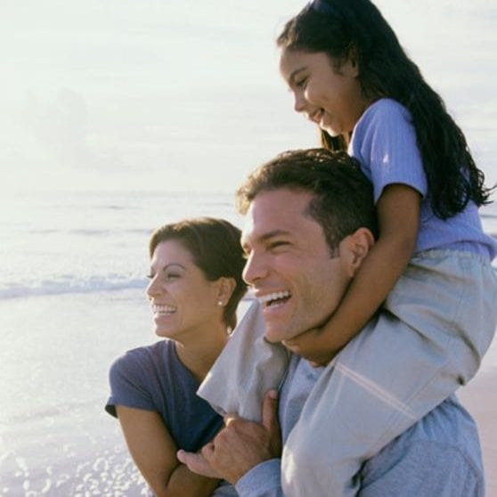 Father and mother together with their daughter at