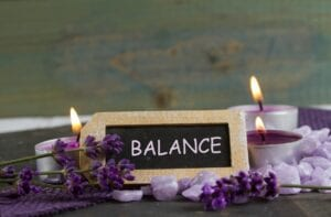 Balance sign and lit candles